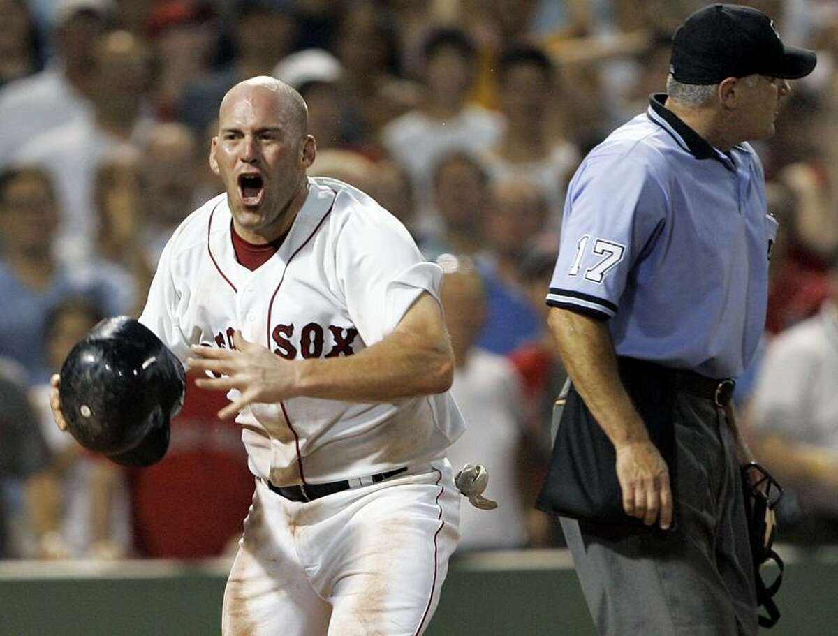 Associated Press The next time Kevin Youkilis pops his cork over an umpire's call, he'll be doing it in a Yankees unform. The former Red Sox star signed a one-year deal with the Bronx Bombers on Tuesday.