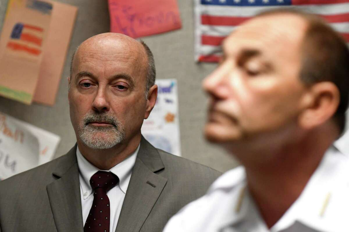 Mayor Patrick Madden, left, listens as Troy Police Chief John Tedesco holds a press briefing to provided updates on Wednesday, Aug. 16, 2017, at the Troy Police Station in Troy, N.Y., on the Tuesday night incident where a man was shot by a city officer. Dahmeek McDonald, 22, was stopped by officers because he was wanted for a parole violation. (Will Waldron/Times Union)