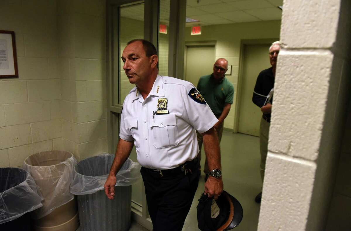 Troy Police Chief John Tedesco enters a briefing room to provided updates on Wednesday, Aug. 16, 2017, at the Troy Police Station in Troy, N.Y., on the Tuesday night incident where a man was shot by a city officer. Dahmeek McDonald, 22, was stopped by officers because he was wanted for a parole violation. (Will Waldron/Times Union)