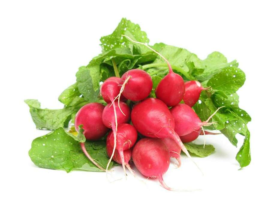 Tribune Media Services photo: Flavor and nutrients reside in the skin: Radishes contain dietary fiber, vitamin C, folate and potassium. Photo: TMS Photo