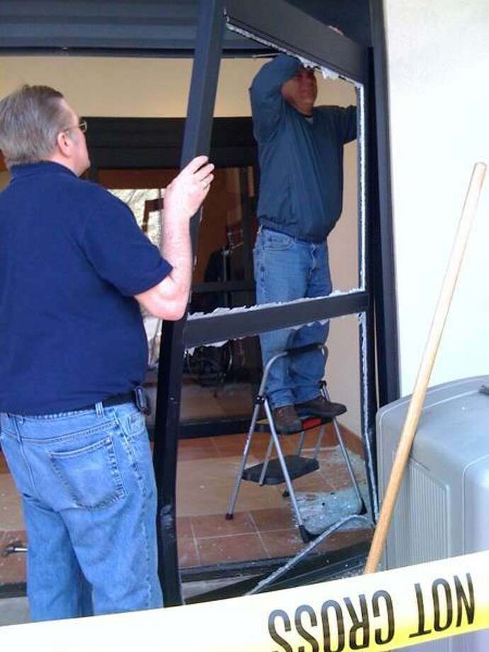 Liberty Dialysis employees cleared away shattered glass then worked to remove the front doors of the center at 510 Washington Ave., North Haven, after a car smashed into the building Tuesday morning. (Ann DeMatteo/Register)