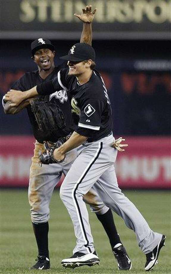 Chicago White Sox left fielder Juan Pierre, left, congratulates right fielder Brent Lillibridge after Lillibridge made two ninth-inning catches for the final two outs in the White Sox's 3-2 victory over the New York Yankees in a baseball game at Yankee Stadium on Tuesday, April 26, 2011, in New York. (AP Photo/Kathy Willens) Photo: AP / AP