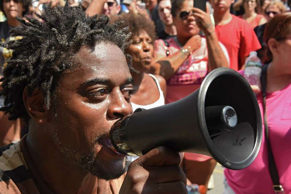 William Felder of Troy speaks into a megaphone outside Troy City Hall during a protest of the shooting of Dahmeek McDonald on Wednesday, Aug. 16, 2017 in Troy, N.Y. A police officer shot the 22-year-old during a traffic stop. (Lori Van Buren / Times Union)