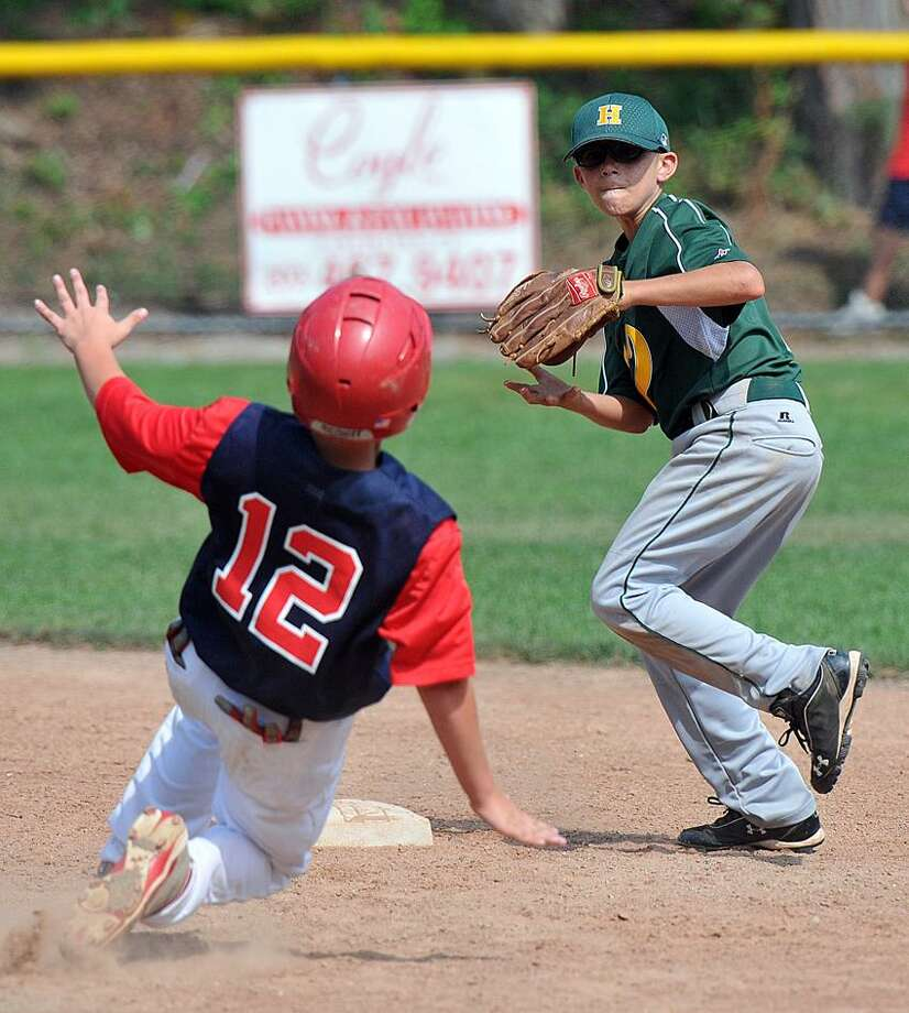 New Haven-- Hamden's Brendan Kirck tries to turn the double play as Annex's Jim Schlouder slides into second base during the 4th inning. He was out. Peter Casolino/New Haven Register