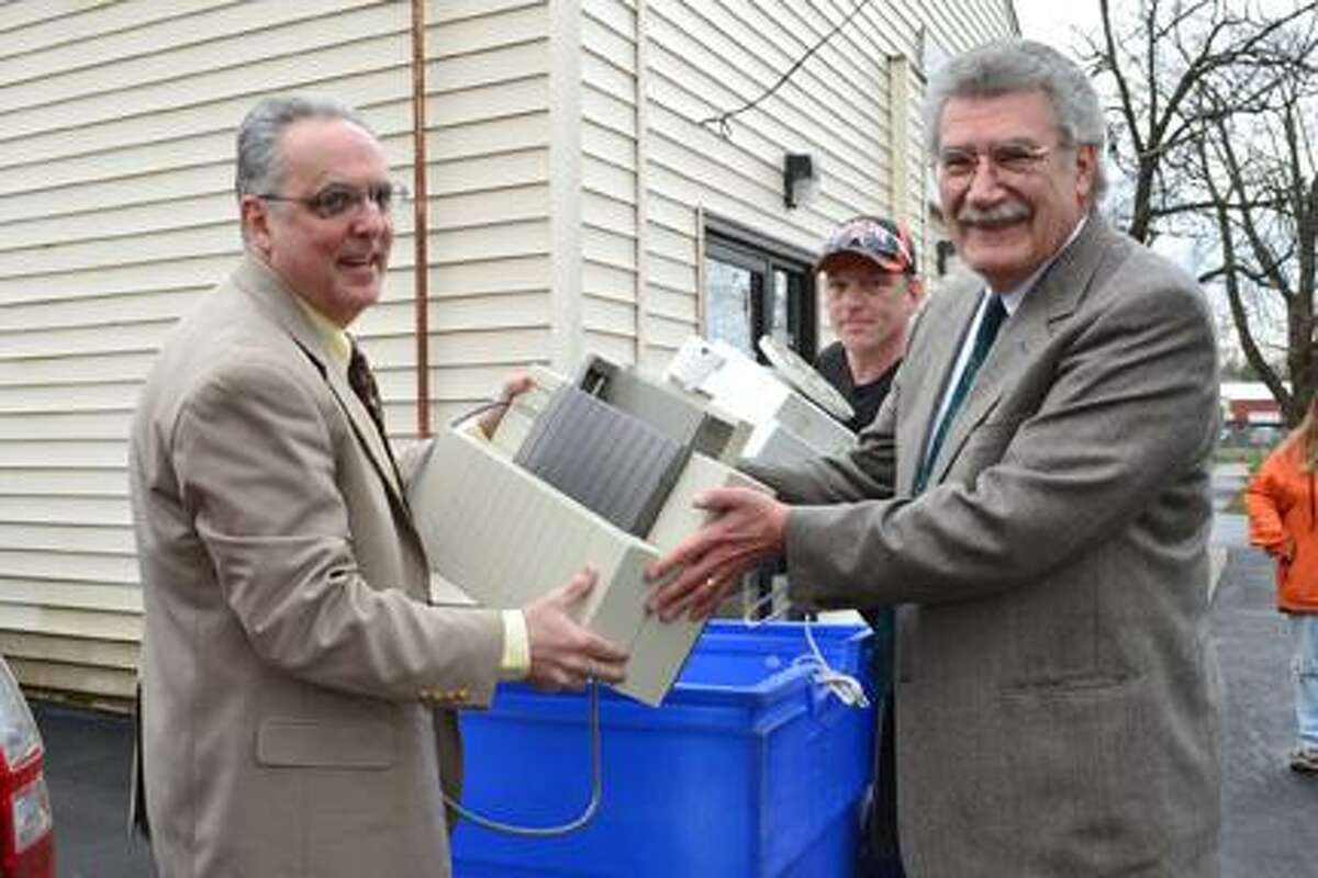 Submitted PhotoJim Zecca, Director of Madison County Solid Waste and Sanitation and Raymond Lewandowski, Executive Director of Madison Cortland ARC together load a printer into an E-Waste collection bin as Jim Bouyea, of LoJo Technology looks on.