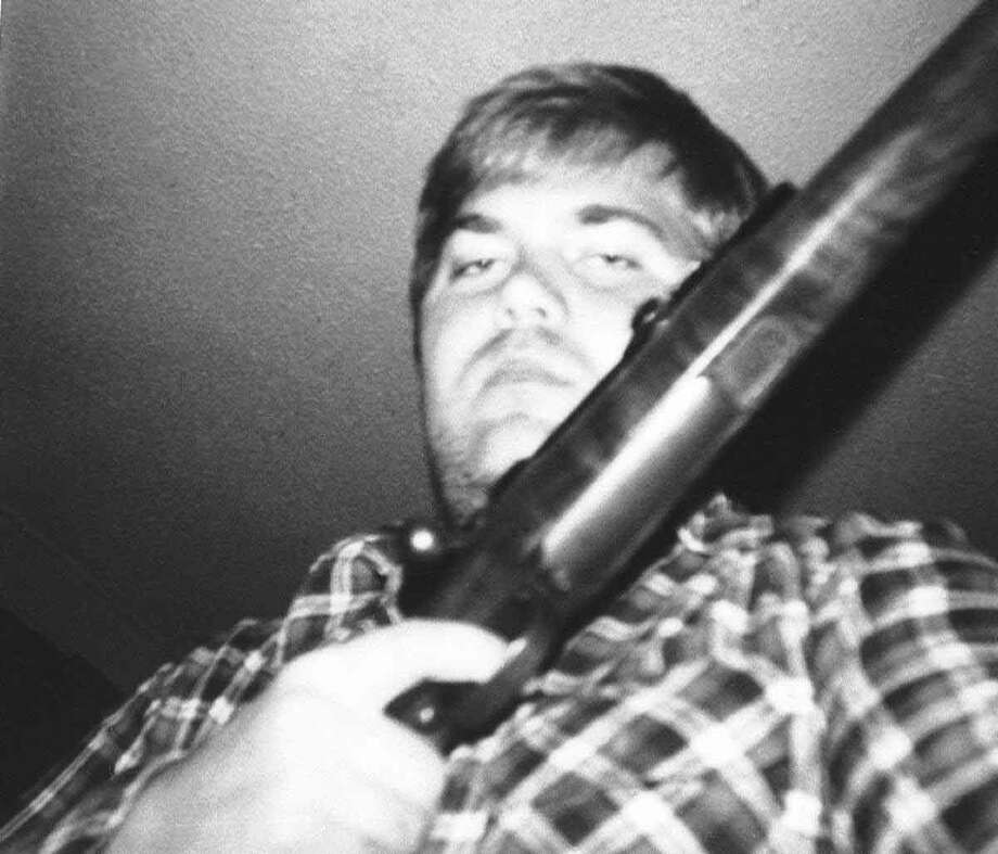 John W. Hinckley Jr., who attempted to assassinate President Ronald Reagan, holds a rifle in Washington on Oct. 29, 1982.  Associated Press Photo: ASSOCIATED PRESS / AP1982