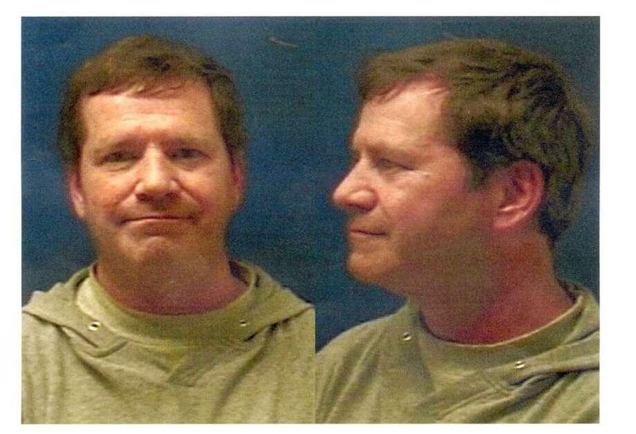 Watson's police mug shot.