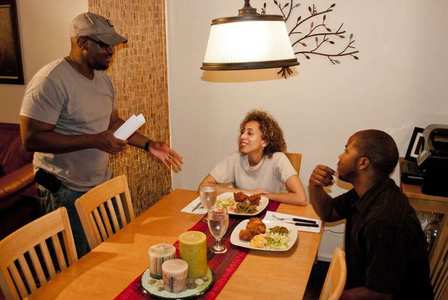 """Contributed photo: """"Love Unconditional"""" filmmaker Willie Mobley of Derby, left, discusses a scene with actors Trina Rocheford and Aaron Johnson."""