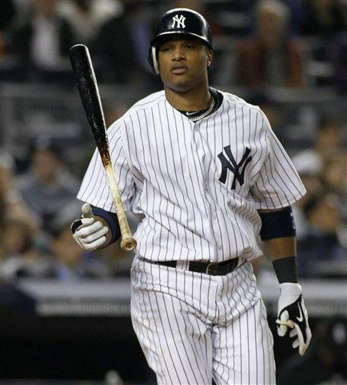 New York Yankees Robinson Cano flips his bat after striking out swinging with two runners on board in the Yankees 2-0 loss to the Chicago White Sox Monday in New York. (AP Photo/Kathy Willens)