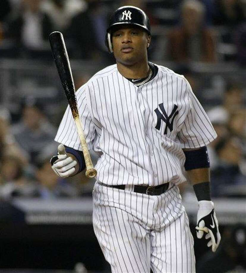 New York Yankees Robinson Cano flips his bat after striking out swinging with two runners on board in the Yankees 2-0 loss to the Chicago White Sox Monday in New York. (AP Photo/Kathy Willens) Photo: AP / AP