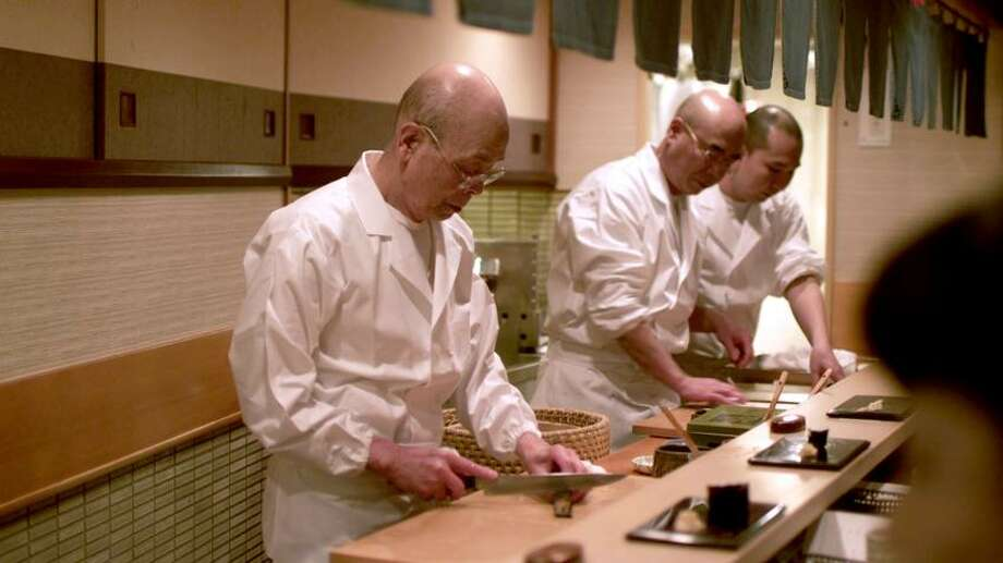 "Magnolia Pictures: Arguably the world's best sushi chef, Jiro Ono, here working in the kitchen of his Tokyo restaurant, is featured in the documentary ""Jiro Dreams of Sushi."""
