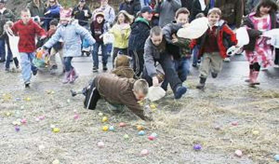 Photo by JOHN HAEGER Children search for the 5,000 eggs placed out during the annual Lenox Easter Egg Hunt on Saturday, April 23, 2001 in the Village of Canastota.