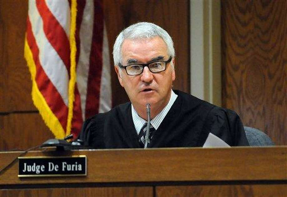 Judge Rick De Furia sentences Shawn Tyson at his murder trial at Sarasota County Court on Wednesday in Sarasota, Fla. Tyson received a life sentence after a jury convicted him of first-degree murder in the shooting deaths of two young British tourists last April.  Associated Press Photo: AP / Dan Wagner/Herald-Tribune Media Group