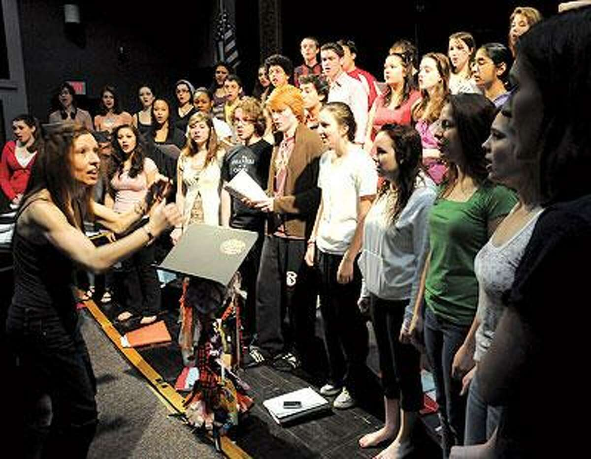 Musical and Choral Director Cathyann Roding rehearses Branford High's award-winning Concert Choir for the benefit concert for the Basic Needs Program at Branford Counseling Center. The concert is May 1 at Woolsey Hall. (Mara Lavitt/Register)