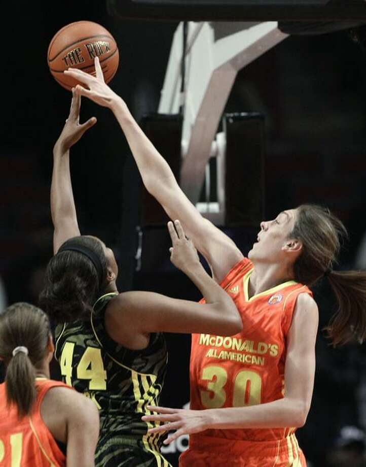 East's Breanna Stewart,(30) from North Syracuse, N.Y., blocks the shot of West's Morgan Tuck (44) from Bolingbrook, Ill., during the first half of the McDonald's All-American girls' basketball game in Chicago, Wednesday, March 28, 2012. (AP Photo/Nam Y. Huh) Photo: AP / AP