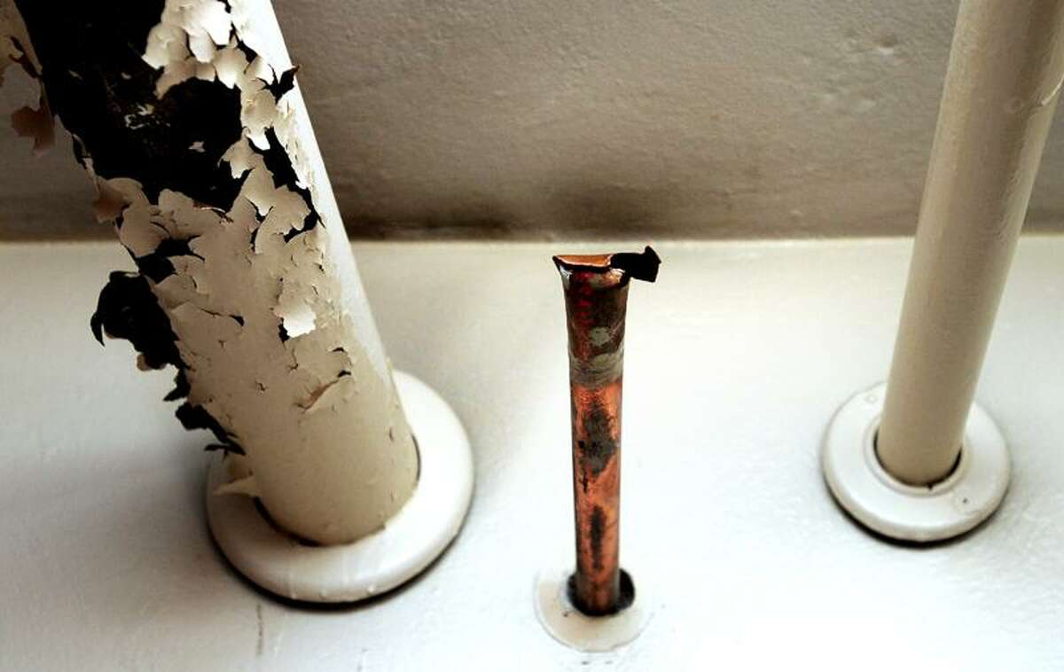 Copper piping (center) was cut and stolen from the basement of Emanuel Lutheran Church at 280 Humphrey St. in New Haven earlier in the week. The church also suffered water damage in the basement.Photo by Arnold Gold/New Haven Register AG0409D