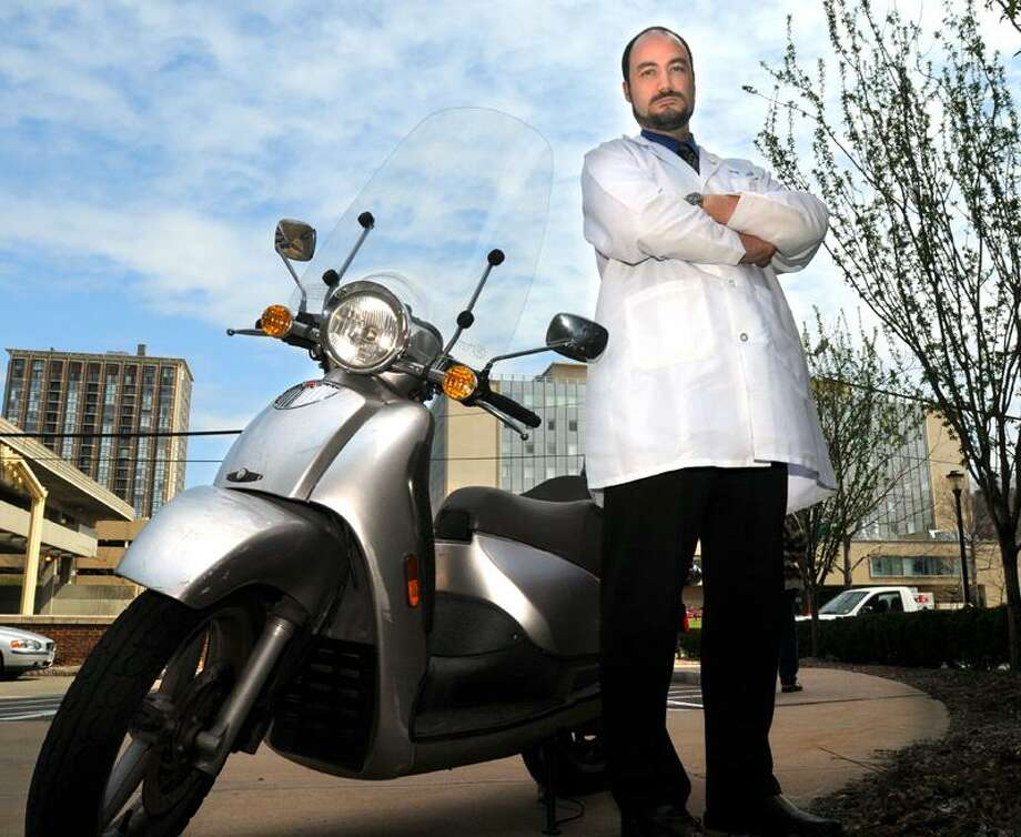 Mara Lavitt/New Haven Register photo: Yale neurologist Michael Phipps, shown here, and Dr. Adam Landman, a former emergency room physician at Yale-New Haven, studied motorcycle helmet use data on 9,214 crashes in Connecticut from 2001 to 2007.