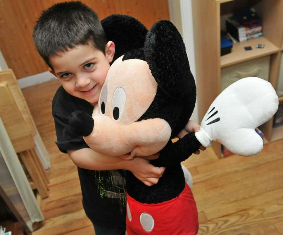Brad Horrigan/Register photo: The state chapter of the Make-A-Wish Foundation sent Alex Criscio, 5, of West Haven and his family to, you guessed it, Disney World in Orlando, Fla.