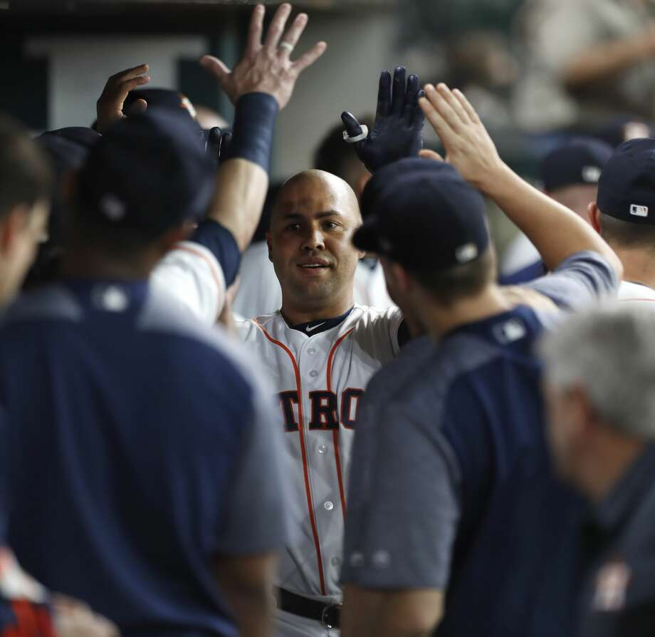 Houston Astros designated hitter Carlos Beltran (15) celebrates in the dugout after his solo home run during the second inning of an MLB game at Minute Maid Park, Wednesday, Aug. 16, 2017, in Houston.  ( Karen Warren / Houston Chronicle ) Photo: Karen Warren/Houston Chronicle