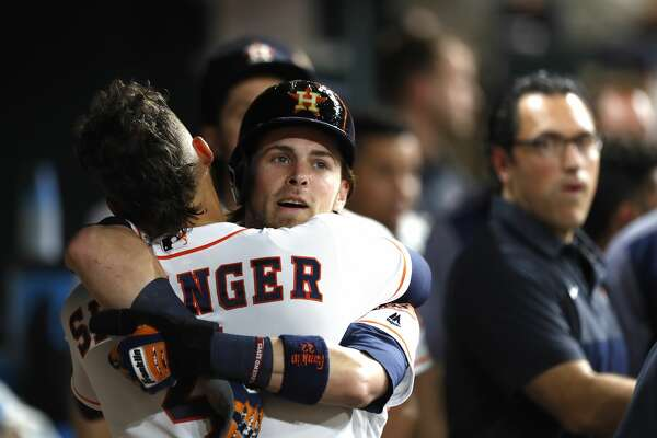 Houston Astros Josh Reddick gets a hug from George Springer in the dougout after scoring a run from first base on Yuli Gurriel's RBI double during the fourth inning of an MLB game at Minute Maid Park, Wednesday, Aug. 16, 2017, in Houston.  ( Karen Warren / Houston Chronicle )
