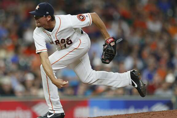 Houston Astros relief pitcher Tyler Clippard (19) pitches during the seventh inning of an MLB game at Minute Maid Park, Wednesday, Aug. 16, 2017, in Houston.  ( Karen Warren / Houston Chronicle )
