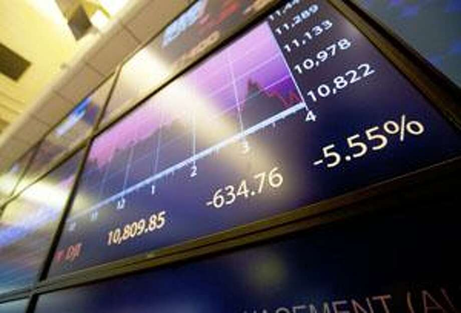 AP Photo by Jin Lee An electronic monitor displays the Dow Jones Industrial Average on the floor of the New York Stock Exchange near the close on Monday, Aug. 8, 2011 in New York. The Dow Jones industrials fell 634.76 points as anxiety overtook investors on the first trading day since Standard & Poor's downgraded American debt. It was the sixth worst point decline for the Dow in the last 112 years and the worst one-day drop since December 2008. Every stock in the Standard & Poor's 500 index declined Monday. Photo: ASSOCIATED PRESS / AP2011