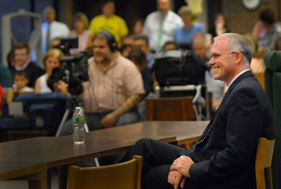Guilford's new superintendent of Schools, Paul Freeman,                 smiles as he is introduced at the Board of Education meeting at Guilford High School.    Melanie Stengel/Register