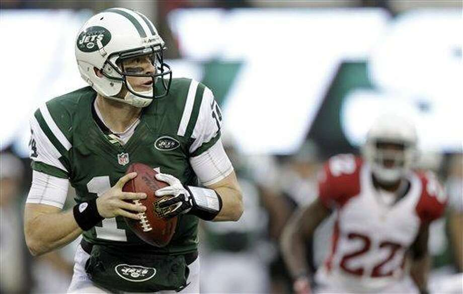 New York Jets quarterback Greg McElroy looks to pass against the Arizona Cardinals during the second half of an NFL football game, Sunday, Dec. 2, 2012, in East Rutherford, N.J. (AP Photo/Kathy Willens) Photo: AP / AP