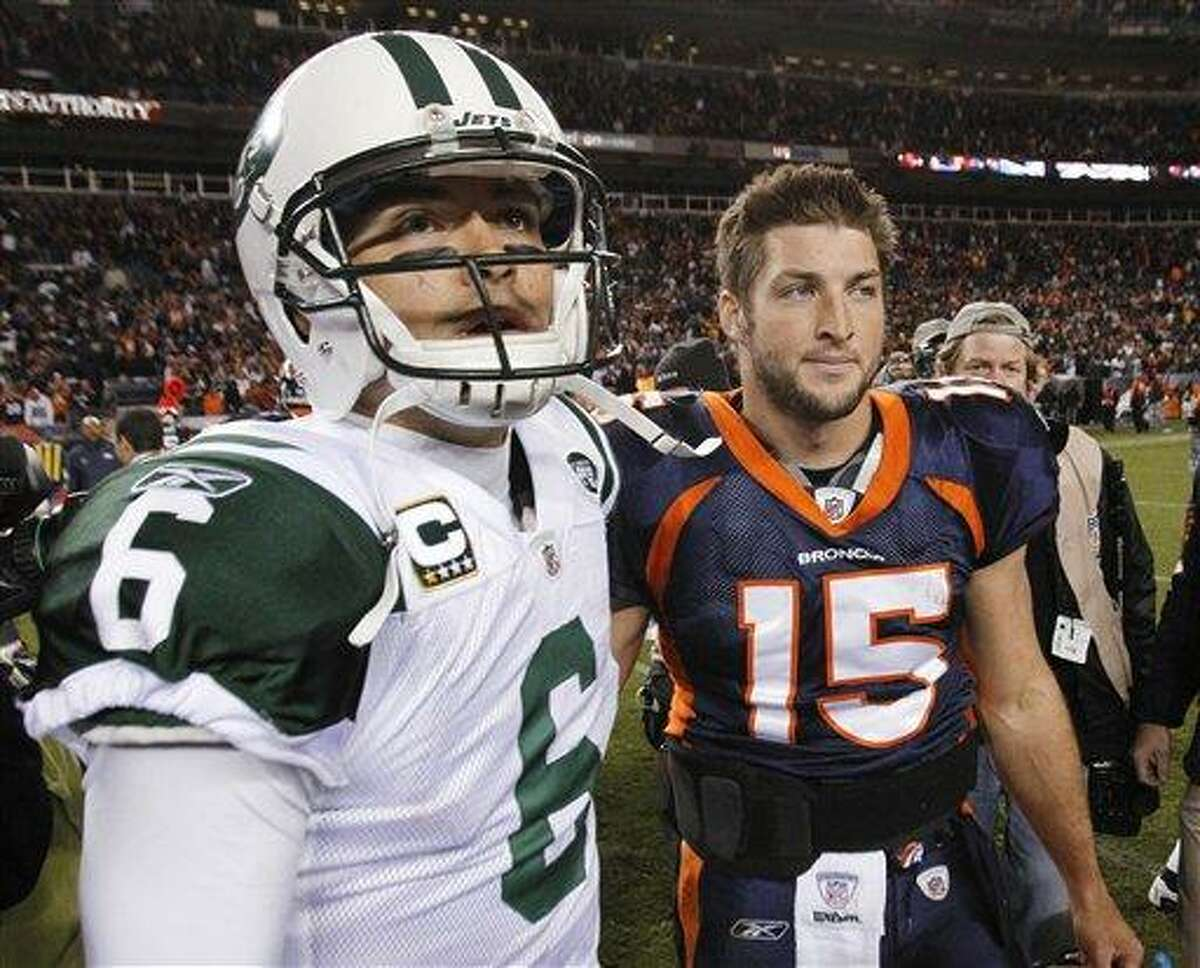 FILE - In this Nov. 17, 2011 file photo, New York Jets quarterback Mark Sanchez (6) and Denver Broncos quarterback Tim Tebow (15) walk off the field together after an NFL football game, in Denver. Tebow has been traded from the Denver Broncos to the New York Jets. (AP Photo/Barry Gutierrez, File)