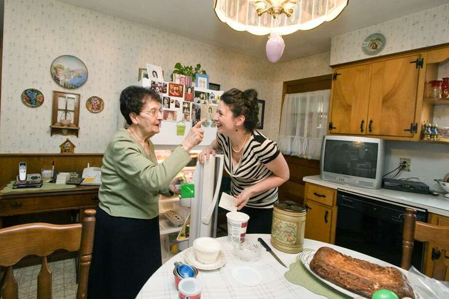 Charlene Ribera Photography photos: Theresa Argento, 88, and Jocelyn Ruggiero in Argento's kitchen in New Haven. They got together recently to make Easter ham pie.