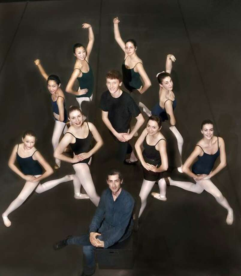 """Melanie Stengel/Register photo: New Haven Ballet dancers from the Spanish corps of """"The Nutcracker"""" take a rehearsal break with Artistic Director Jared Redick, front. Outer circle, from left, Lila Brown, Hamden; Catherine Valloso, East Haven; Hayley Germaine, Guilford; Christa Ventresca, Guilford; Elyse Estra, Woodbridge; and Alice Perrigo, Seymour. Inner circle, Alaina Hartnett, Clinton; Owen Prum, New Haven; and Julia Antinozzi, Woodbridge."""