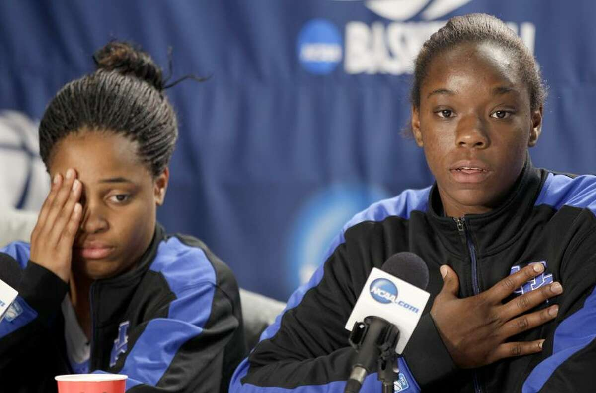 Kentucky center Samarie Walker, right, responds to the idea of playing against her former team as guard Bria Goss listens during a media availability in Kingston, R.I., Monday, March 26, 2012. Kentucky is scheduled to play Connecticut in a women's NCAA tournament East Regional final college basketball game on Tuesday in Kingston. (AP Photo/Stephan Savoia)
