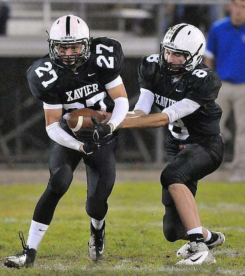 Middletown--  Xavier vs West Haven football action.   Photo--Peter Casolino/New Haven Register. 11/12/12