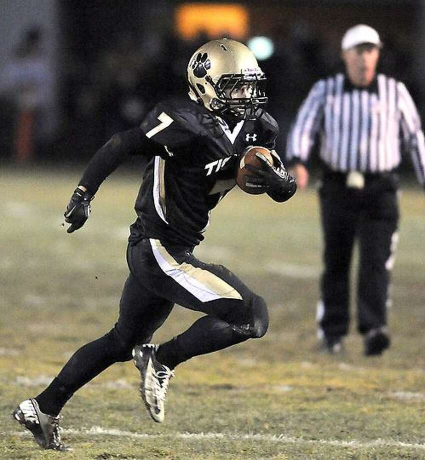 Matthew Sullivan of Daniel Hand runs against Platt in the first half of the CIAC quarterfinal in Madison on 11/28/2012.Photo by Arnold Gold/New Haven Register   AG0473B
