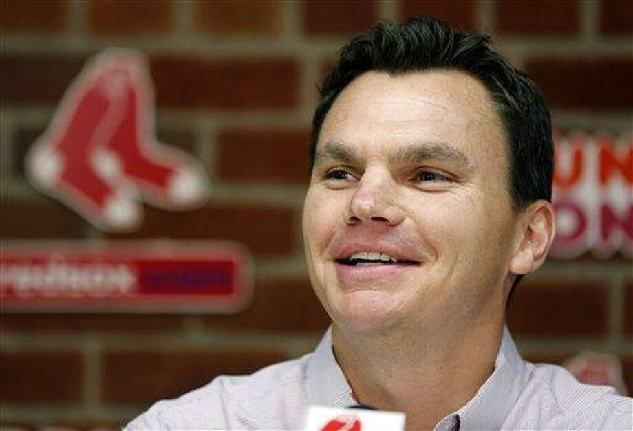FILE - In this Aug. 25, 2012, file photo, Boston Red Sox general manager Ben Cherington speaks at a news conference before a baseball game between the Red Sox and the Kansas City Royals in Boston. The Red Sox have a lot of money to spend at this year's winter meetings, but Cherington isn't sure that's the way to go. He said on Saturday that there is more than one way to rebuild after last year's 93-loss season.  (AP Photo/Michael Dwyer, File) Photo: AP / AP