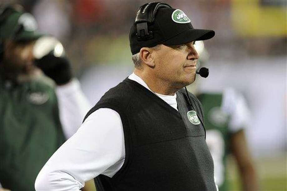 New York Jets head coach Rex Ryan reacts after quarterback Mark Sanchez fumbled and New England Patriots' Steve Gregory returned it for a touchdown during the first half of an NFL football game on Thursday, Nov. 22, 2012, in East Rutherford, N.J. (AP Photo/Bill Kostroun) Photo: AP / FR51951 AP