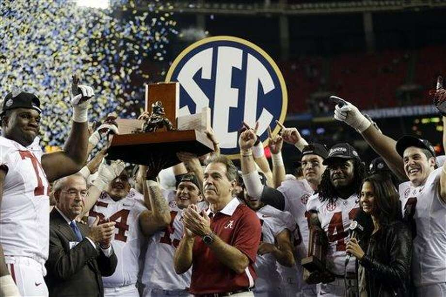 Alabama head coach Nick Saban and his players celebrate after their 32-28 win in the Southeastern Conference championship NCAA college football game against Georgia, Saturday, Dec. 1, 2012, in Atlanta. (AP Photo/David Goldman) Photo: AP / AP
