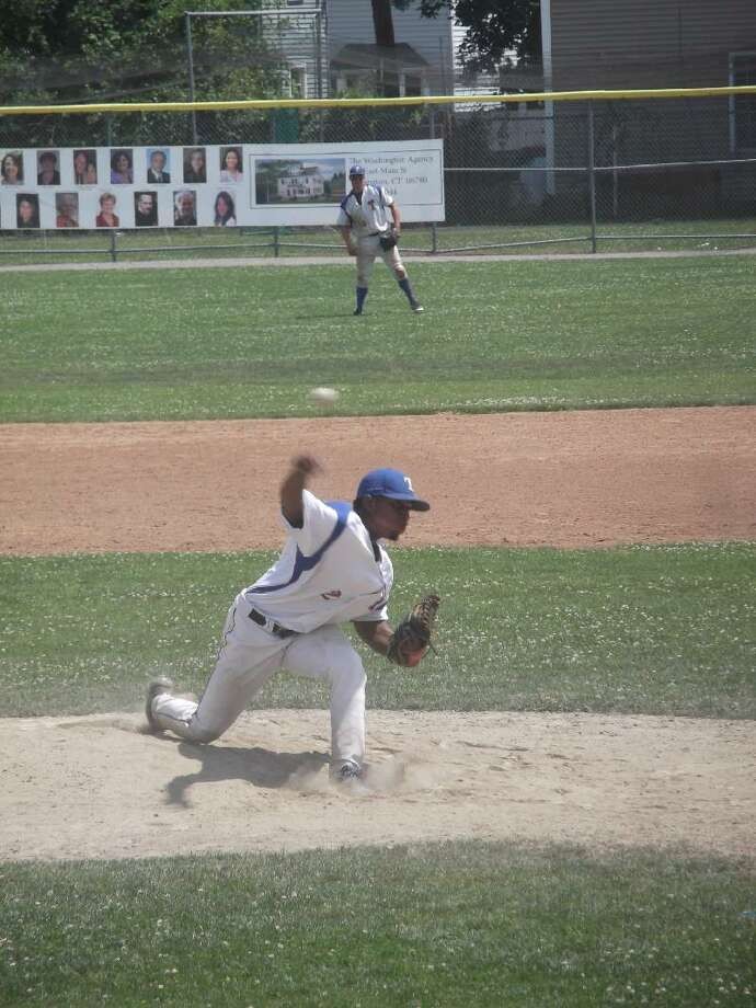 KEVIN D. ROBERTS/Register Citizen Torrington's Joe Mateo delivers a pitch as right fielder Quentin Kindred gets into position during the second game of Sunday's doubleheader at Fuessenich Park. The teams split the doubleheader, with Burlington/Harwinton taking the first game 6-2 and the P38s winning the second game 1-0. Mateo threw a complete game to pick up the victory in the second game.