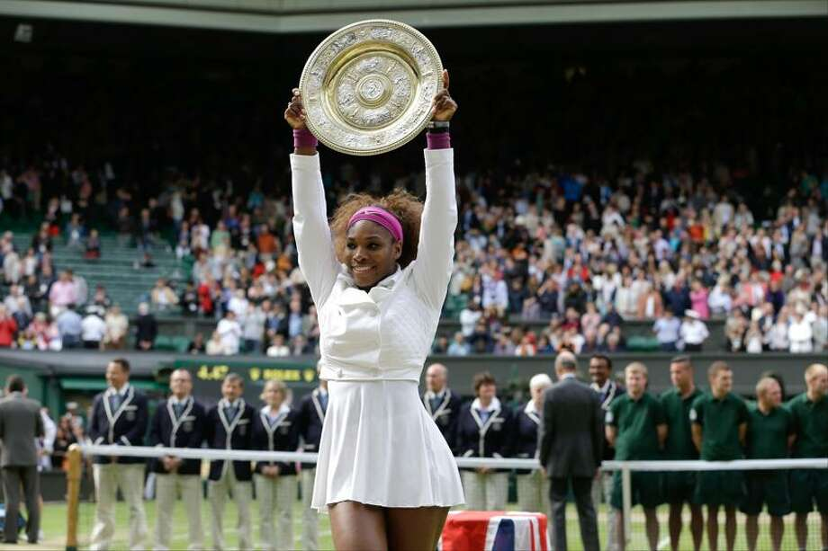 Serena Williams of the United States against Agnieszka Radwanska of Poland during the women's final match at the All England Lawn Tennis Championships at Wimbledon, England, Saturday, July 7, 2012. (AP Photo/Kirsty Wigglesworth) Photo: AP / AP2012