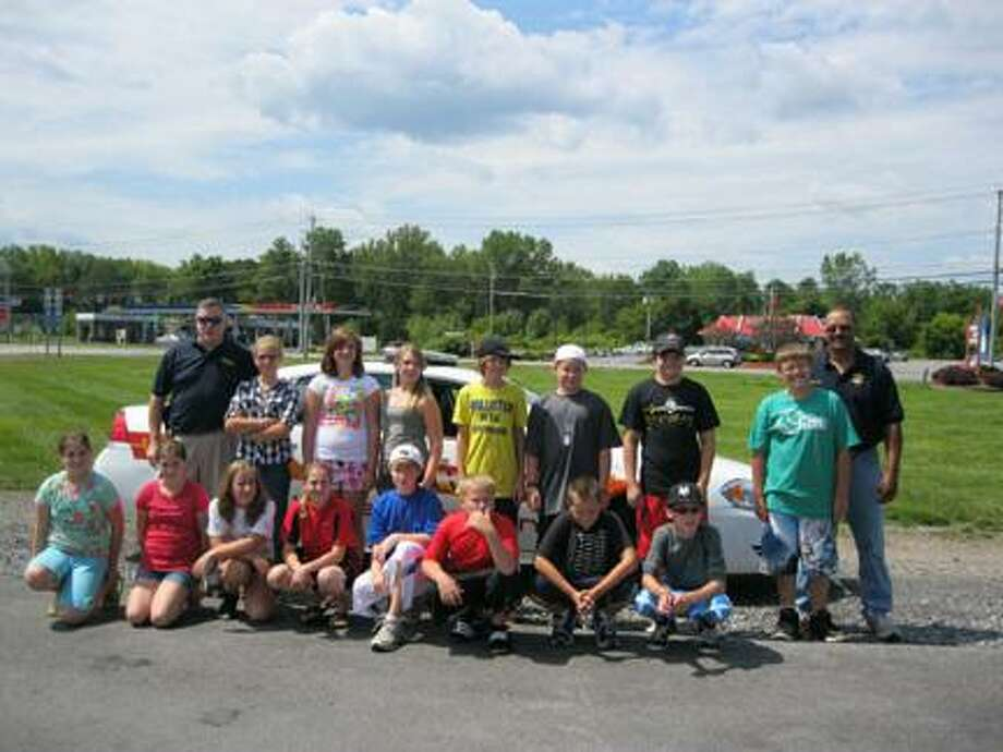 Submitted Photo Front row from left are Hannah Lanning, Caylah Lanning, Kelly Gloo, Alexa Rossi, Cameron Allen, Brenden Allen, Jordan Petrie and Joseph Morat. Back row from left are Undersheriff John Ball, Tayor Jaeger, Keara Lawson, Jessica Burns, Caleb Drew, Nolan Allen, Zachary Cottet, Brendan Petrie and Sheriff Allen Riley