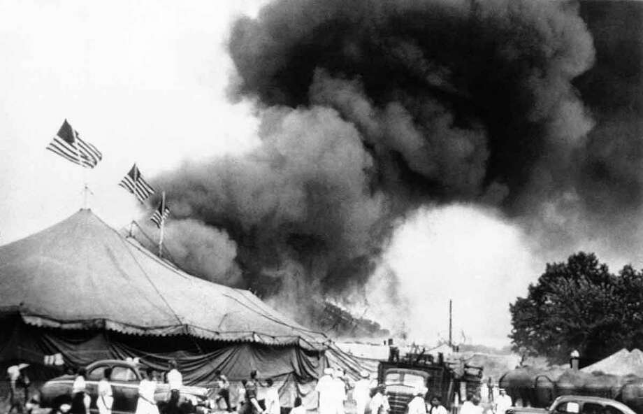 Flames shoot from the top of the main tent of the Ringling Bros. and Barnum & Bailey Circus during performance in Hartford on July 6, 1944. Shortly after, the tent collapsed, trapping many of the patrons, who were still in the arena. Associated Press Photo: ASSOCIATED PRESS / AP1944