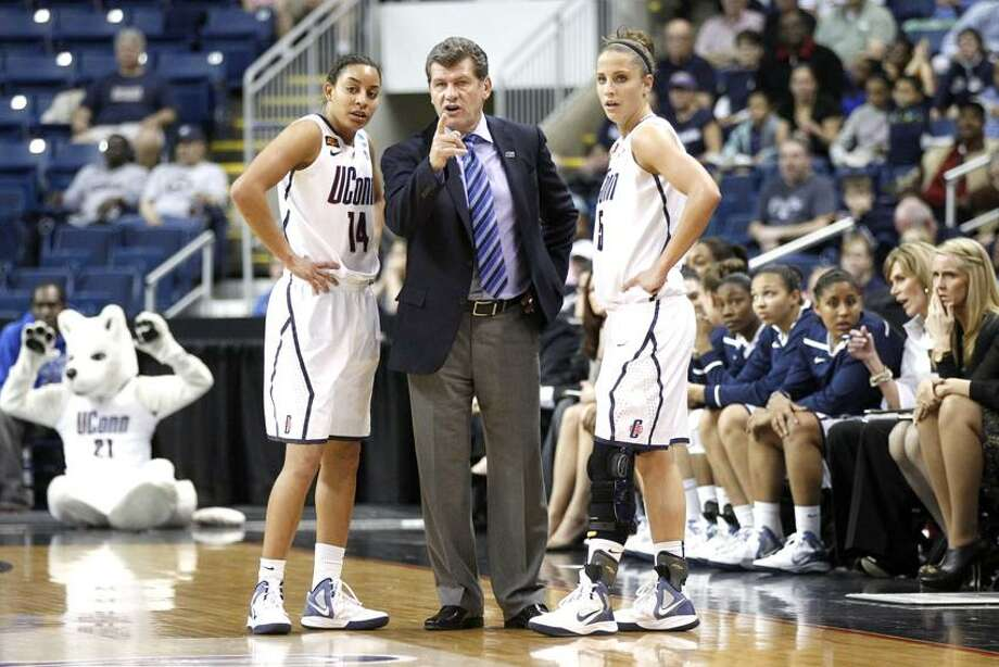 Mar 19, 2012; Bridgeport, CT, USA; Connecticut Huskies head coach Geno Auriemma talks with guard Bria Hartley (14) and guard Caroline Doty (5) during a break in the action against the Kansas State Wildcats during the first half in the second round of the 2012 NCAA women's basketball tournament at Arena at Harbor Yard. UConn defeated the Kansas State Wildcats 72-26.  Mandatory Credit: David Butler II-US PRESSWIRE Photo: US PRESSWIRE / David Butler II
