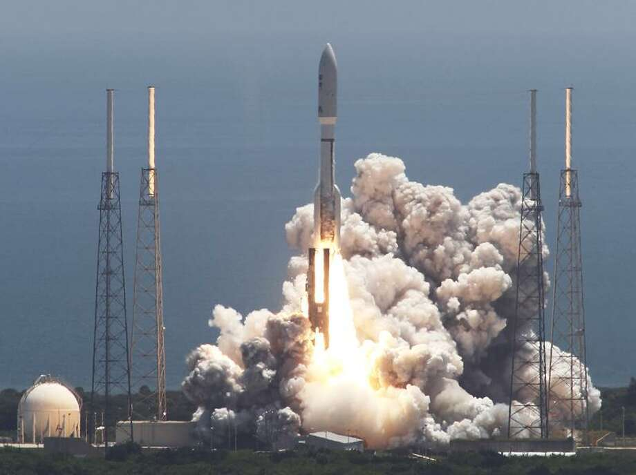 An Atlas V rocket with the Juno spacecraft lifts off Friday from Space Launch Complex-41 in Cape Canaveral, Fla. NASA launched the robotic craft to explore the planet Jupiter. Associated Press Photo: AP / AP2011