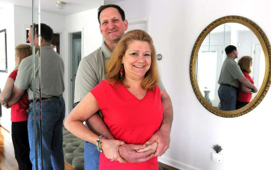Mara Lavitt/Register photo: Kim DeMatteis D'Angelo and Rich D'Angelo of Hamden will celebrate their 20th anniversary Tuesday. She has triumphed over life-changing car accident as well as a stroke.
