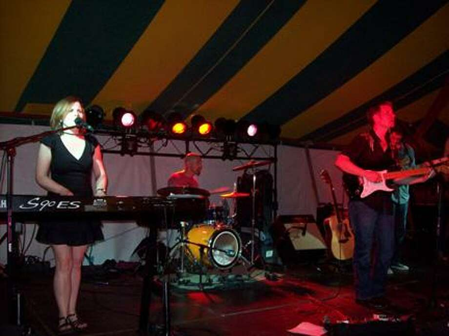 Photo Special to the Dispatch by MIKE JAQUAYSThe Baltimore-based Donegal X-Press, including, from left, keyboardist Laura Hein, drummer and OHS class of 1984 graduate Jeff Trueman, and lead singer/guitarist Brad Dunnells entertain their audience at last year's Sherrill Kenwood Park Festival.
