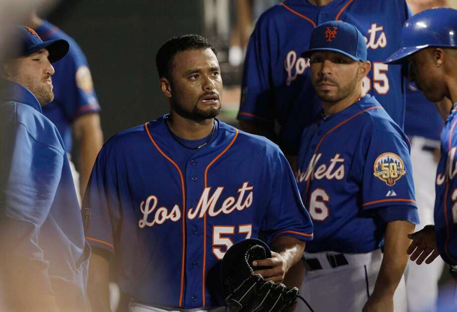 New York Mets starting pitcher Johan Santana (57) walks through the dugout after leaving a baseball game against the Chicago Cubs during the fifth inning Friday, July 6, 2012, in New York.  (AP Photo/Frank Franklin II) Photo: AP / AP2012