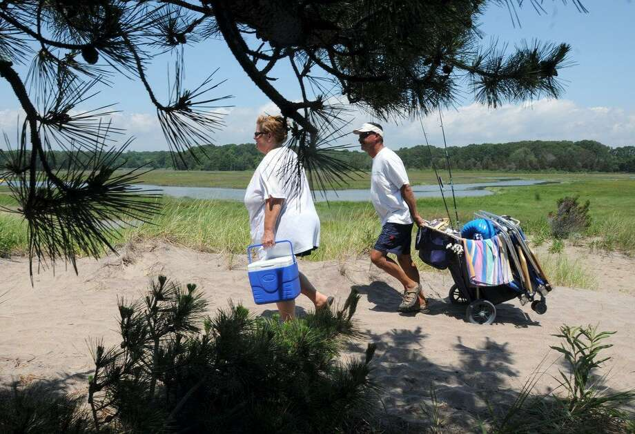Christine and Peter Koster of Naugatuck, Connecticut haul their beach gear from their campsite at Hammonasset Beach State Park Campground to the park's beach in  Madison, Connecticut Wednesday 7/4/12. Photograph by Peter Hvizdak / New Haven Register Photo: New Haven Register / ©Peter Hvizdak /  New Haven Register