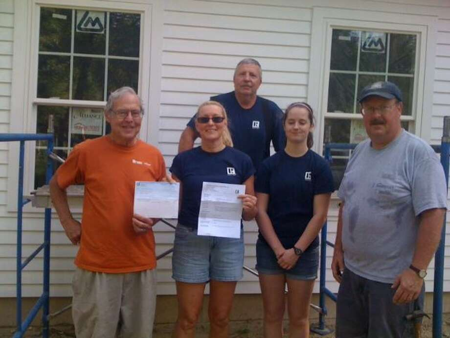 Submitted photo Litchfield County Board of REALTORS, Inc. Public Relations Committee Chair Linda Hull presented Habitat for Humanity of NWCT representative John Pogue with a donation from the board in the amount of $1,000 for use on their current project. Front row, from left, are Pogue, Hull, Patty McAllister and Tom Bartram. In the back row is David Hull.