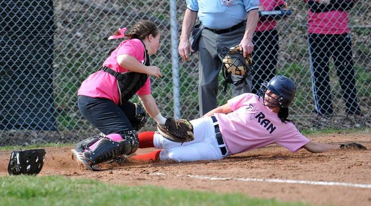 Shelton--Foran's Brooke Phelan slides into home plate safely as as Shelton's Jenn Sicinski tries to make the play during the first inning. Photo by Peter Casolino/New Haven Register04/14/11 Cas110414