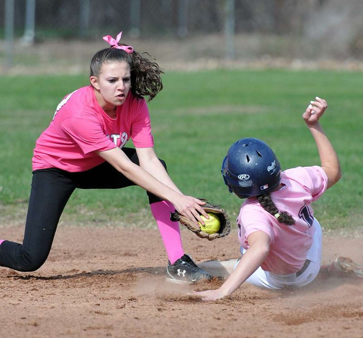 Shelton--Foran's Sage Esposito steals second base as Shelton's Rachel Cautadella tries to make the play during the first inning. Photo by Peter Casolino/New Haven Register04/14/11 Cas110414